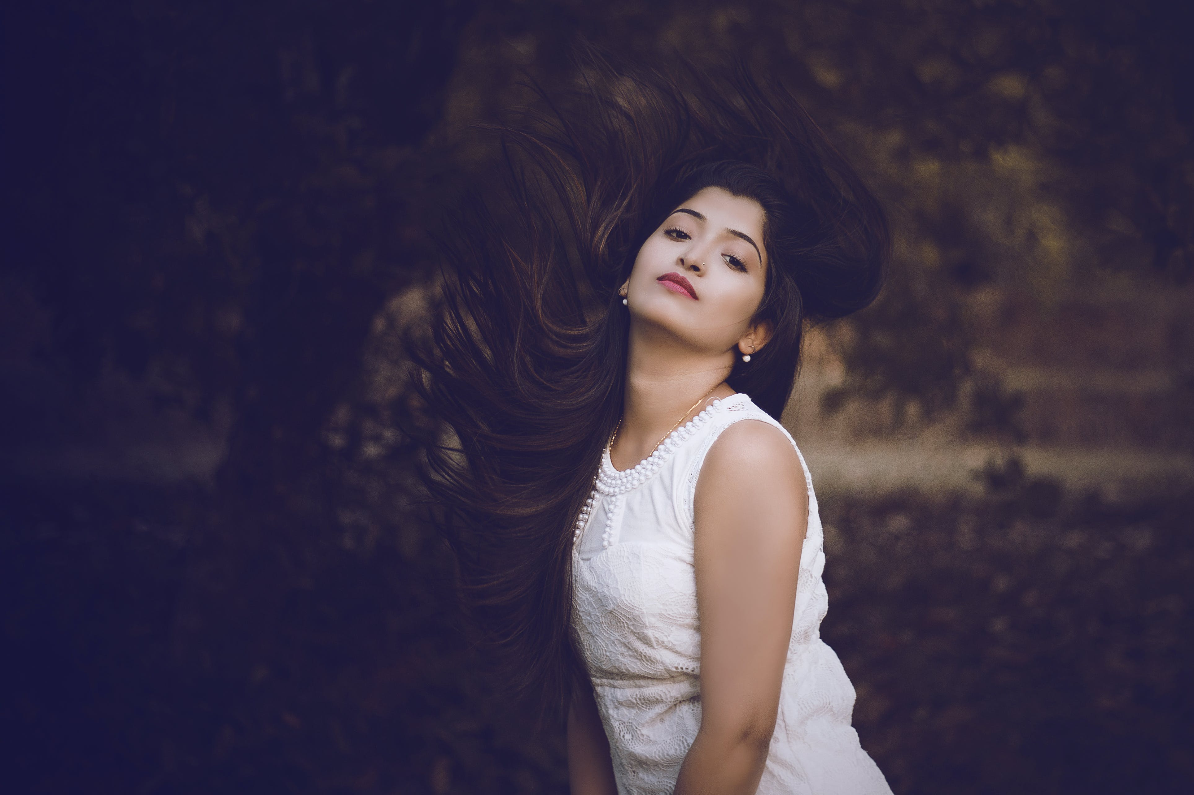 Selective Focus Photography of Woman in White Crew-neck Sleeveless Dress