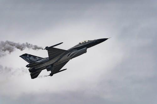 Black Jet Plane Flying in the Sky
