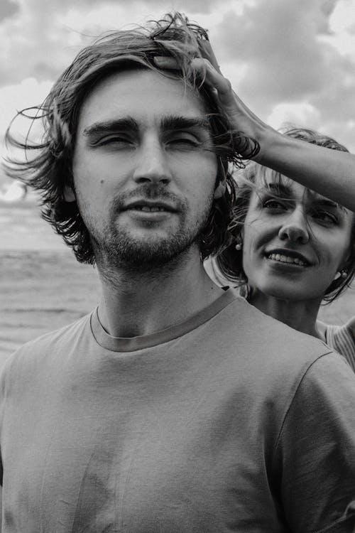 Man and Woman Smiling in Grayscale Photography