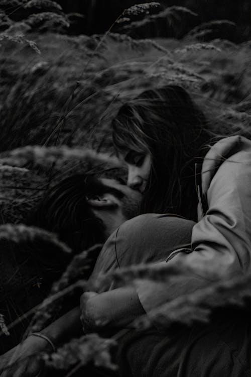 Grayscale Photo of Couple Hugging