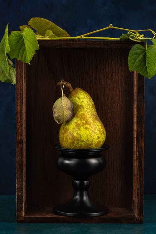 Yellow Fruit on Black Stand