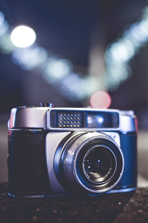 Selective Focus Photo of Gray and Black Slr Camera