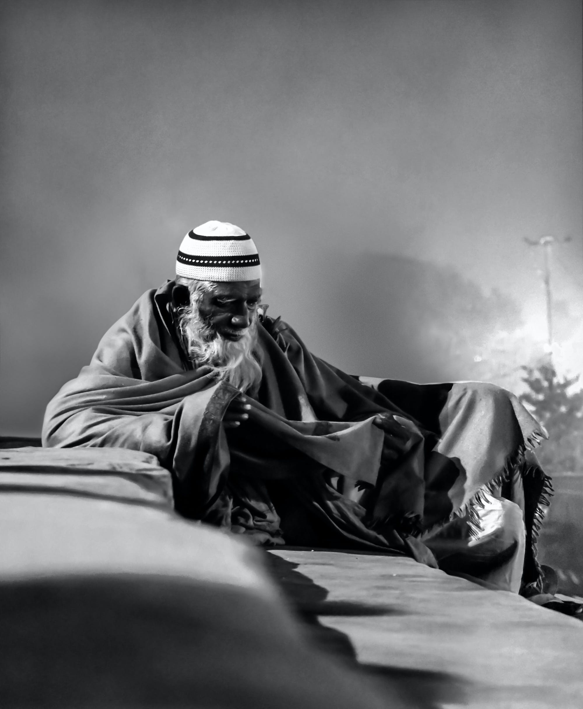 Grayscale Photo of Man With Taqiyah Cap