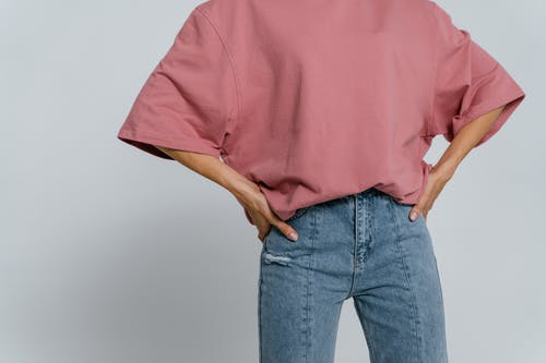 Man in Pink Crew Neck T-shirt and Blue Denim Jeans