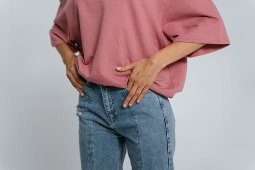 Man in Pink Shirt and Blue Denim Jeans