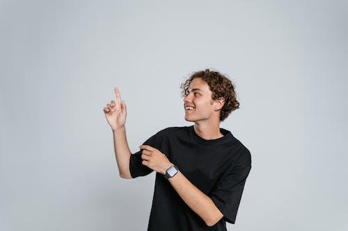 Man in Black Crew Neck T-shirt Wearing Black Watch