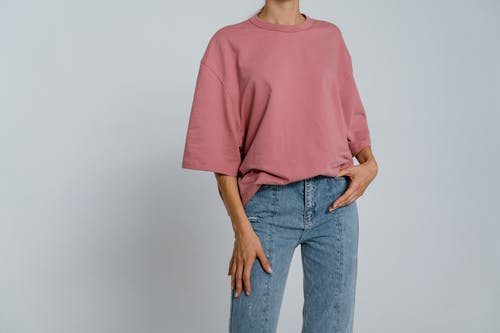 Woman in Pink Crew Neck T-shirt and Blue Denim Jeans