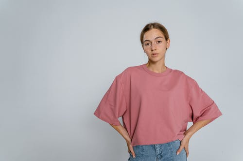 Woman in Red Crew Neck T-shirt and Blue Denim Jeans