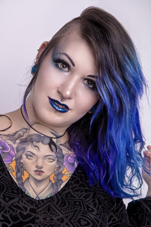 Woman With Blue Hair and Black Eye Shadow