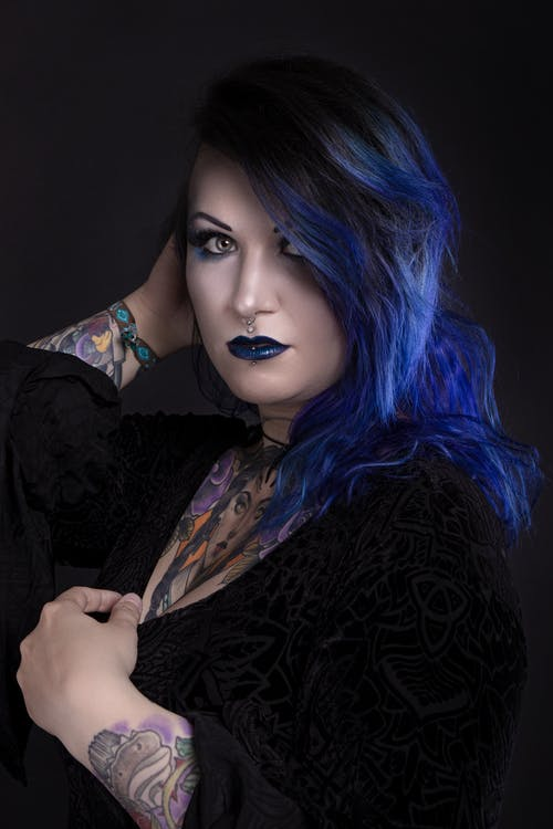 Woman in Black Long Sleeve Shirt With Blue Hair