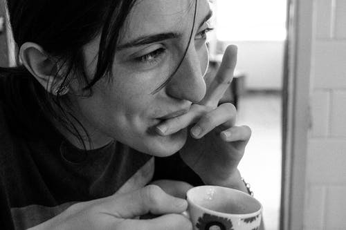 Grayscale Photo of Woman Holding Ceramic Mug