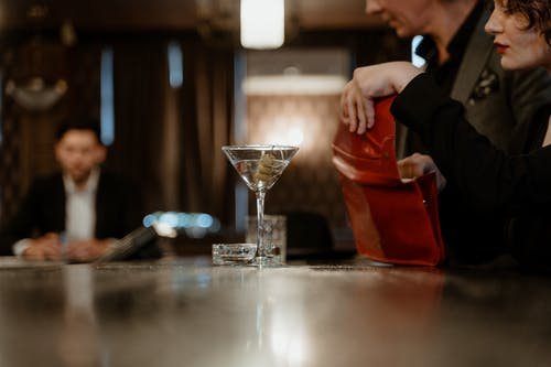 Martini Glass on the Wooden Bar Counter