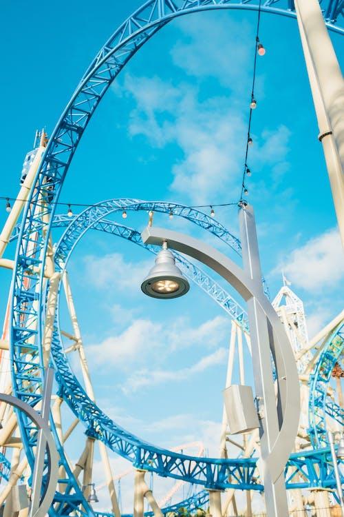 Blue and White Ferris Wheel Under Blue Sky