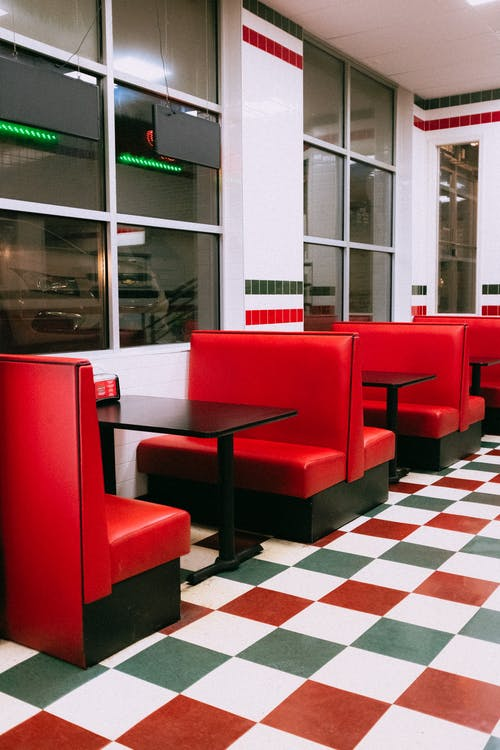 Red Leather Padded Chairs Near Table