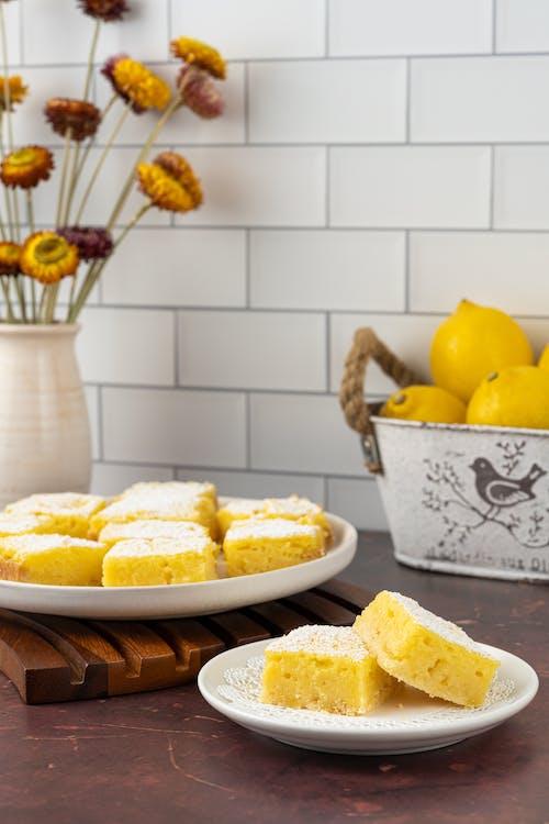 Sliced Yellow Fruit on White Ceramic Bowl