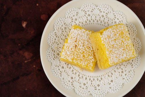Yellow Cheese on White Ceramic Plate