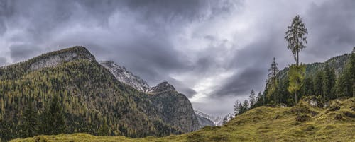 Landscape Photography of Mountains Under Gray Cloudy Sky