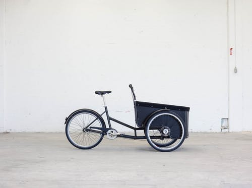 Shallow Photography of Black Steel Adult Trike