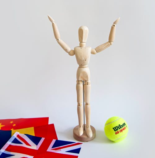Brown Wooden Toy With Green Tennis Ball