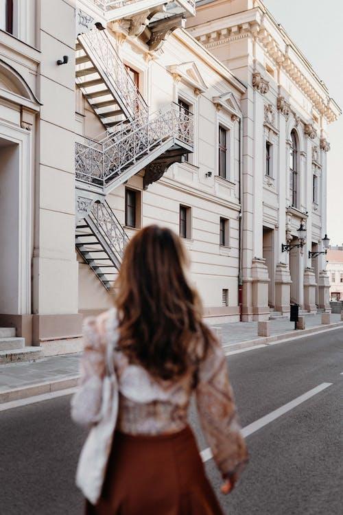 Woman in Brown Fur Coat Standing on Sidewalk
