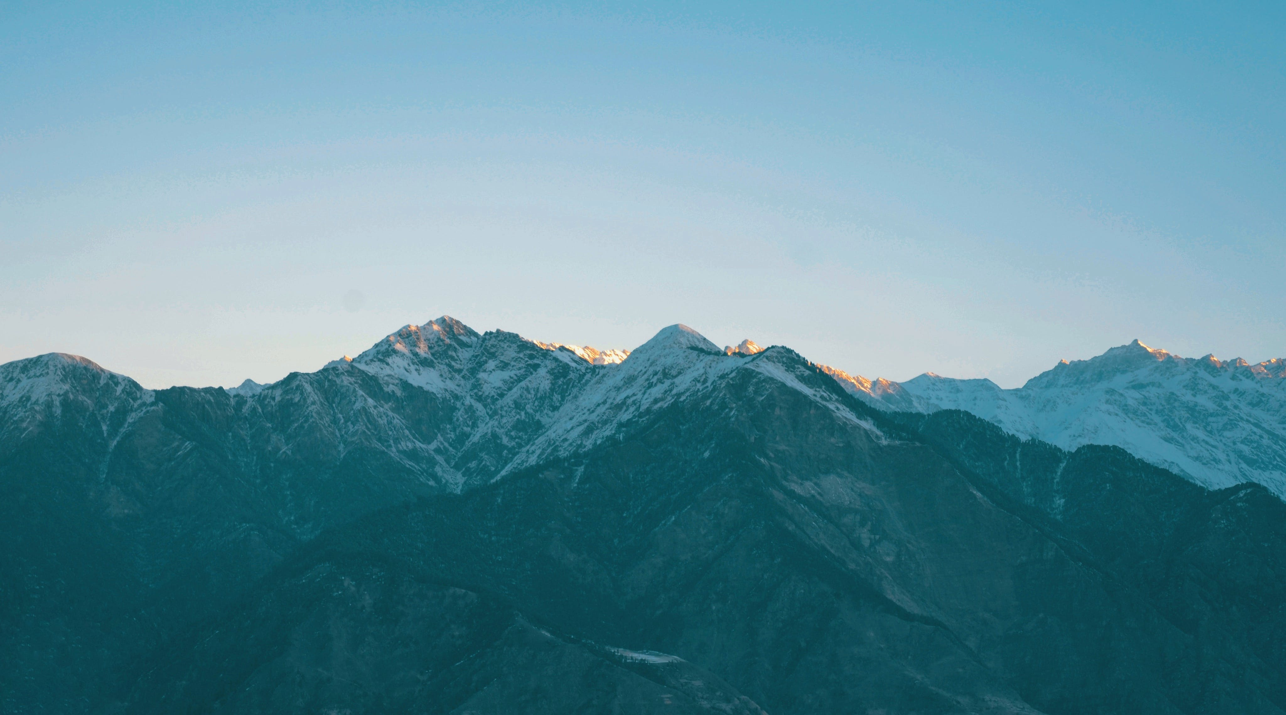 Landscape Photography Of Snow Capped Mountains