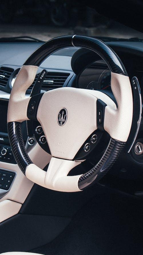 White and Black Toyota Steering Wheel