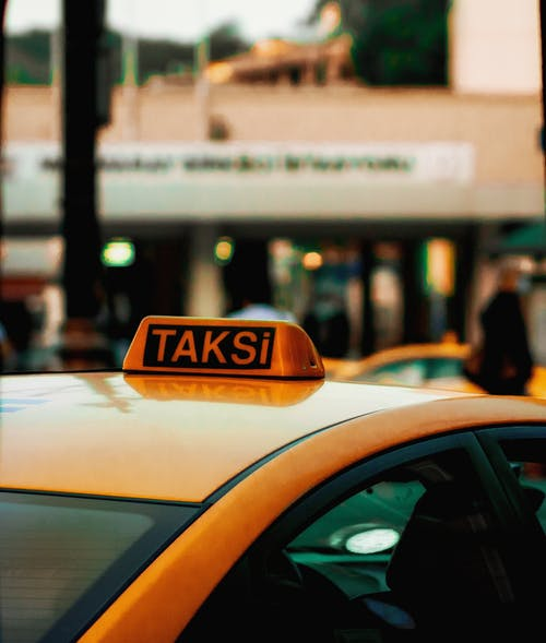 Yellow Taxi Cab in City during Night Time