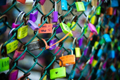 Green Chain-link Fence With Assorted-color Padlocks