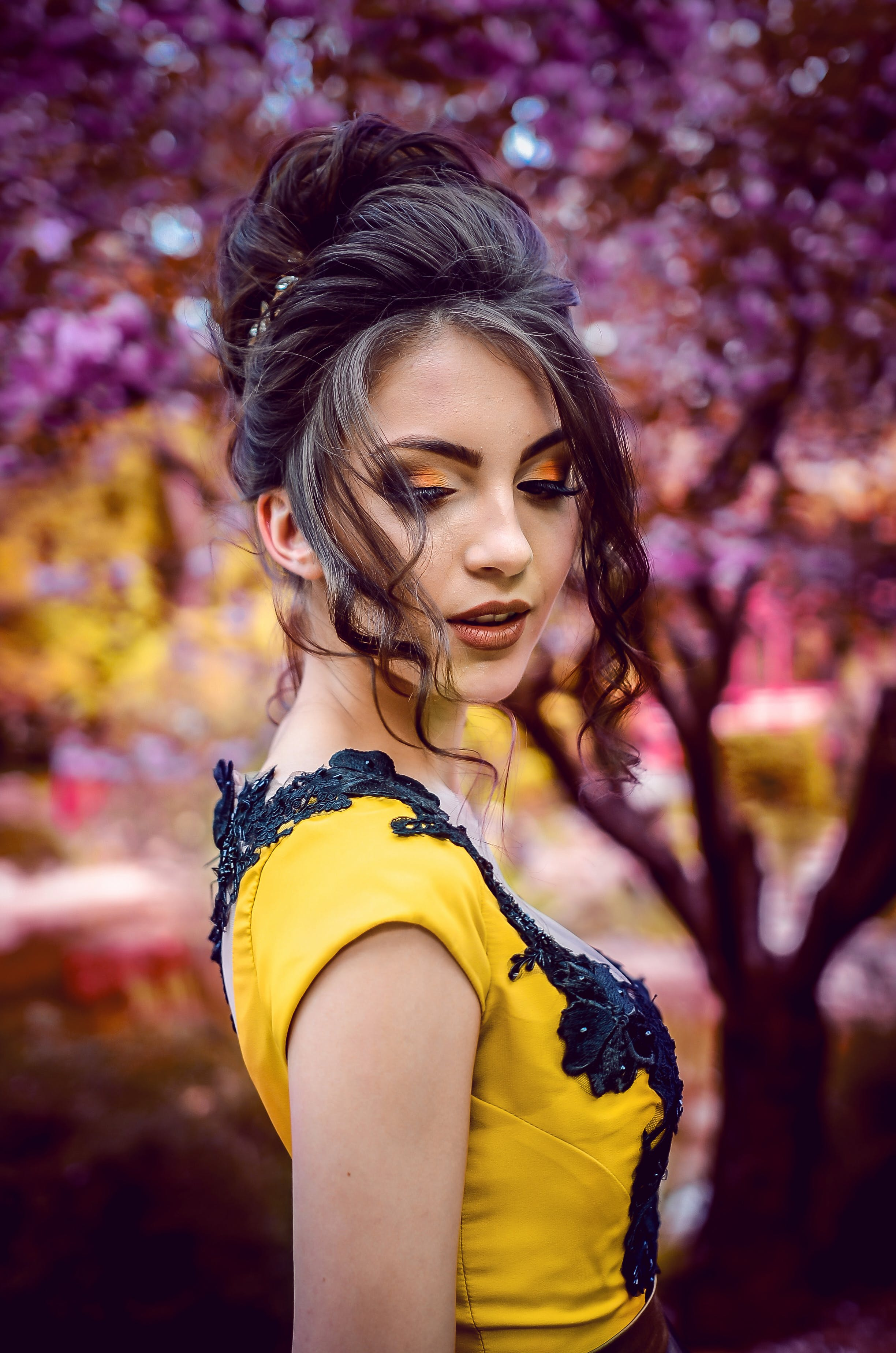 Woman In Yellow And Black Top