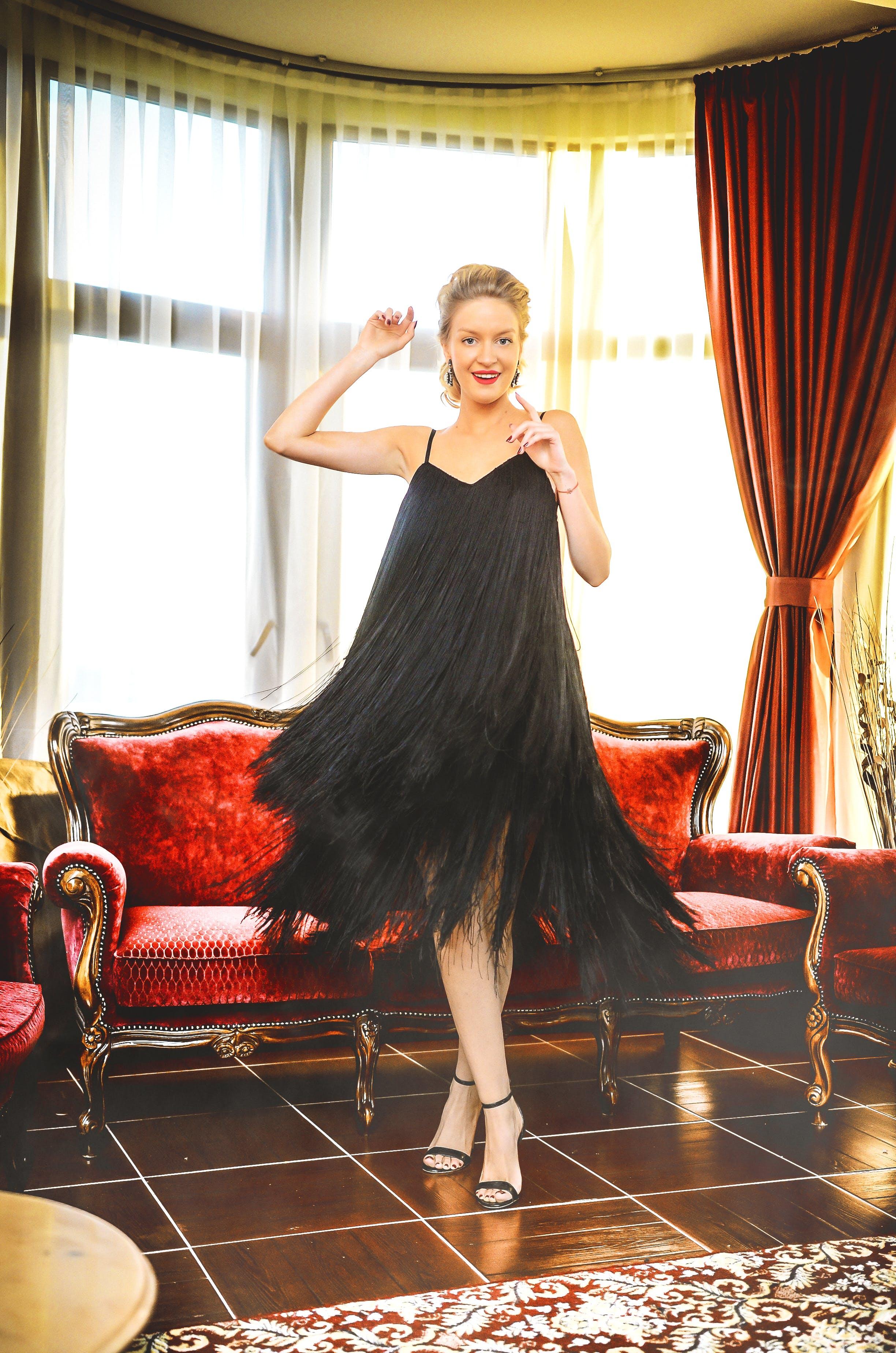 Woman In Black Spaghetti Strap Dress