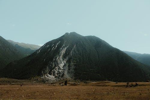 Green and White Mountain Under White Sky