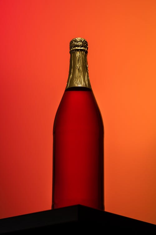 Red Glass Bottle With Red Liquid