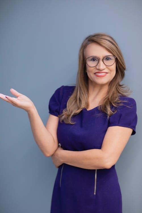 Woman in Eyeglasses Wearing Violet Dress