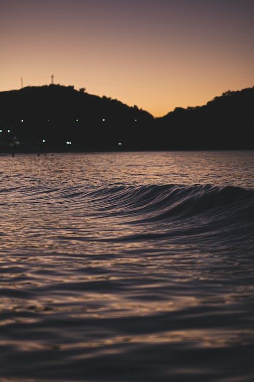 Gratis lagerfoto af bakke, belyst, bølge