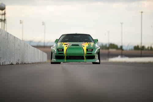 Green Chevrolet Camaro on Road