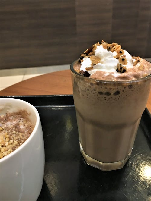 Free stock photo of Hot coffee with nuts and cold chocolate shake