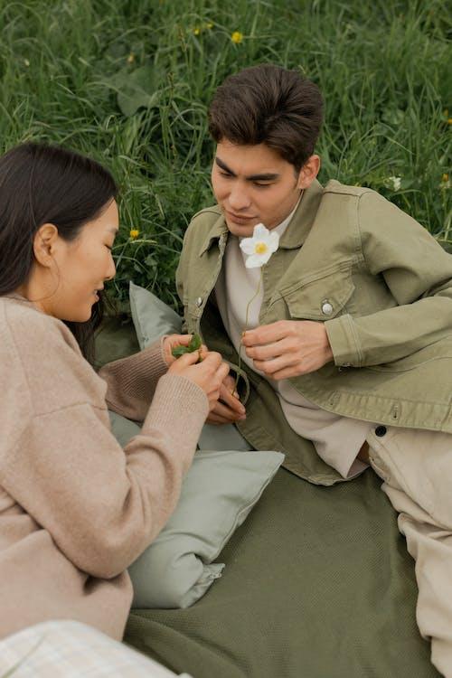 Woman in Brown Coat Kissing Woman in Brown Coat