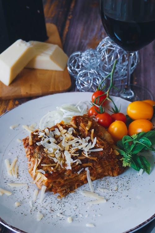 Lasagna Dish with Garnished Shredded Cheese