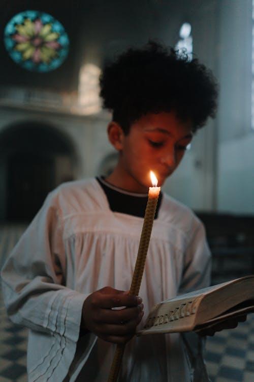 Free stock photo of boy, candle, catholic