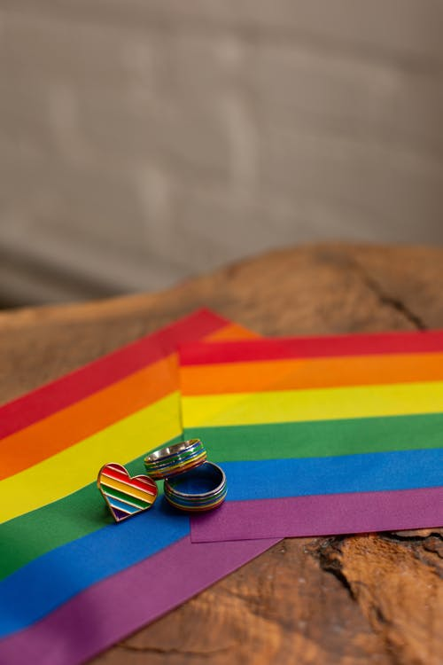 Close-up Photo of Rings on Pride Flag