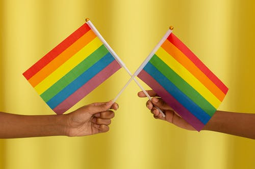 Two People holding Pride Flag