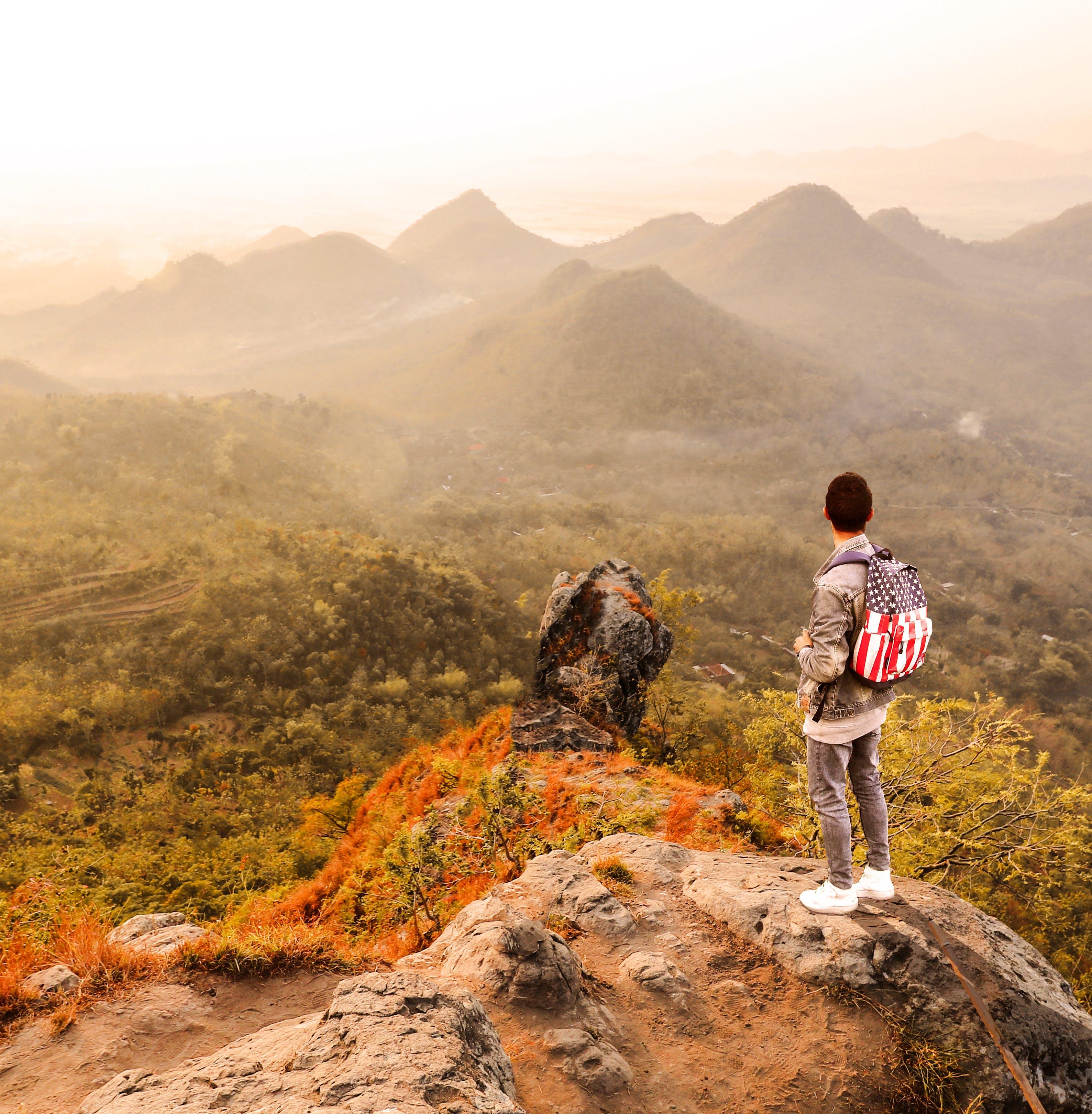 Man Standing on a Mountain Summit