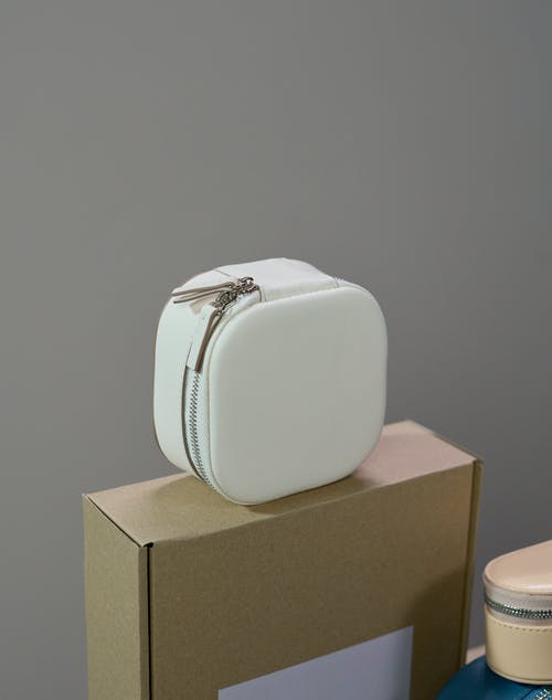 White and Brown Box on Brown Wooden Table