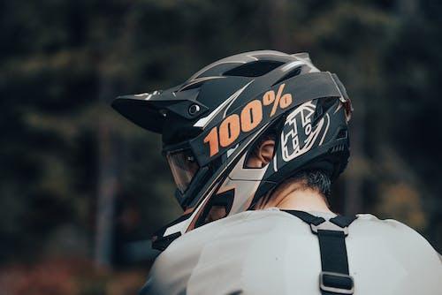 Man in White and Black Helmet