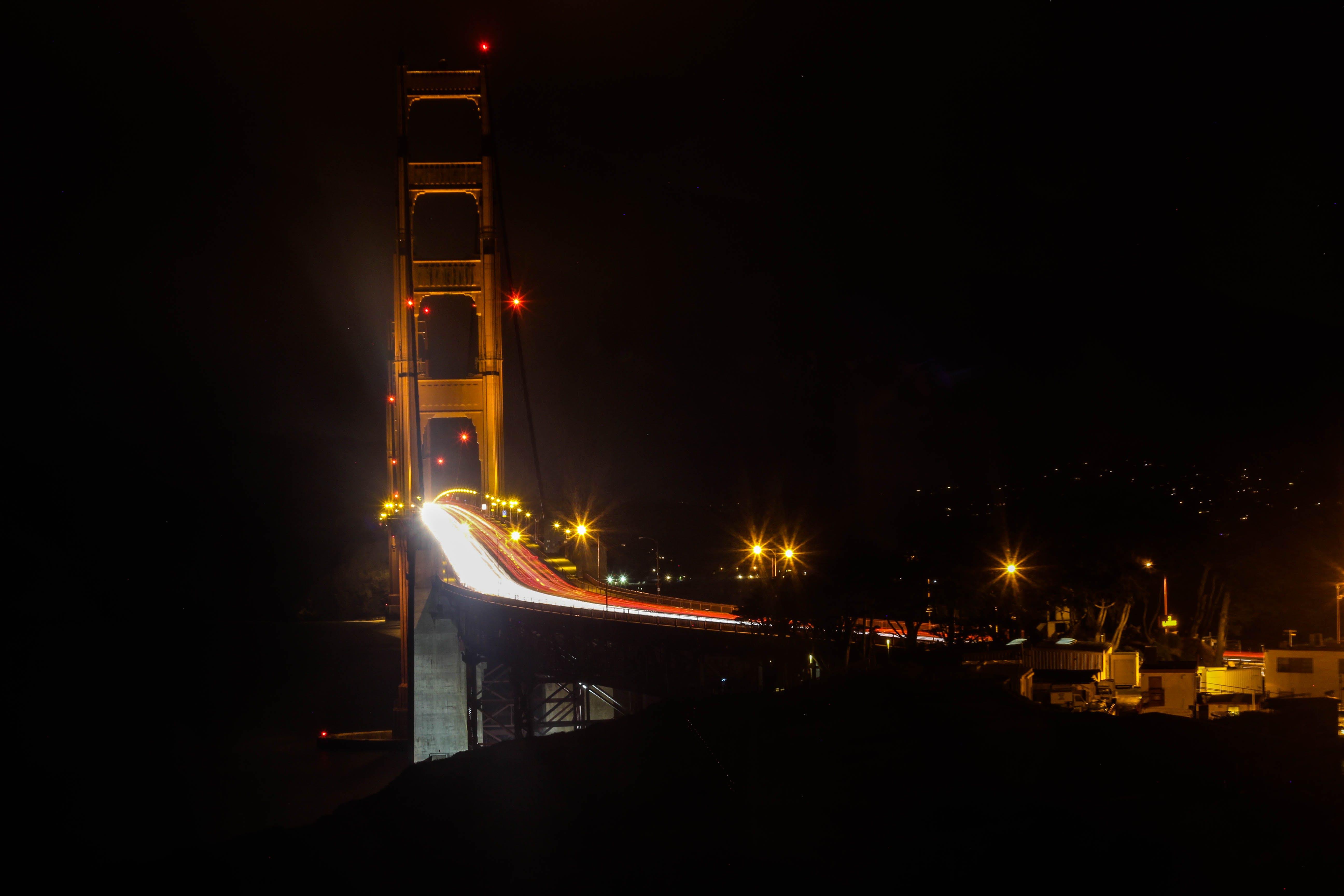Photography of Bridge at Night