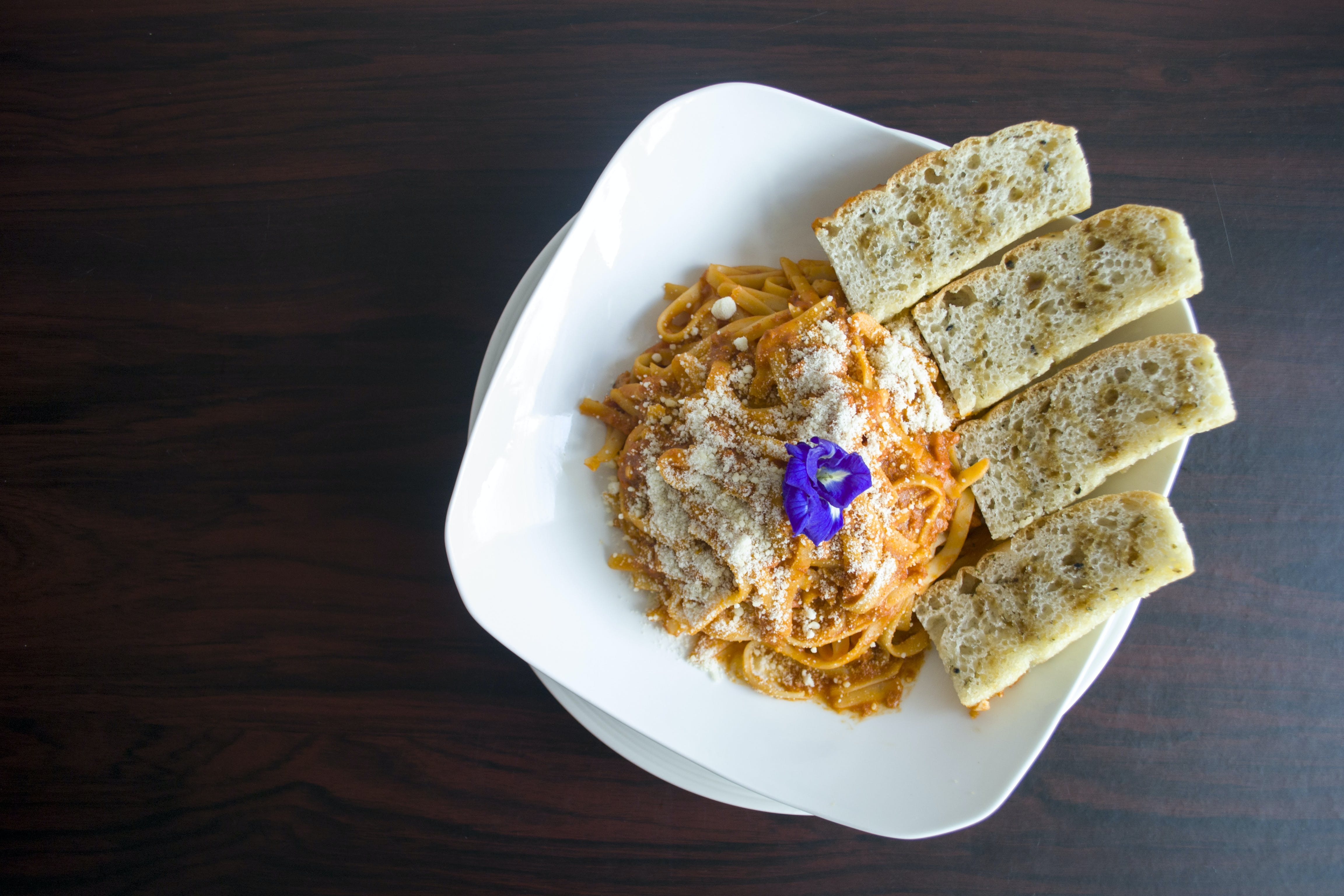 Photography of Pasta with Garlic Bread