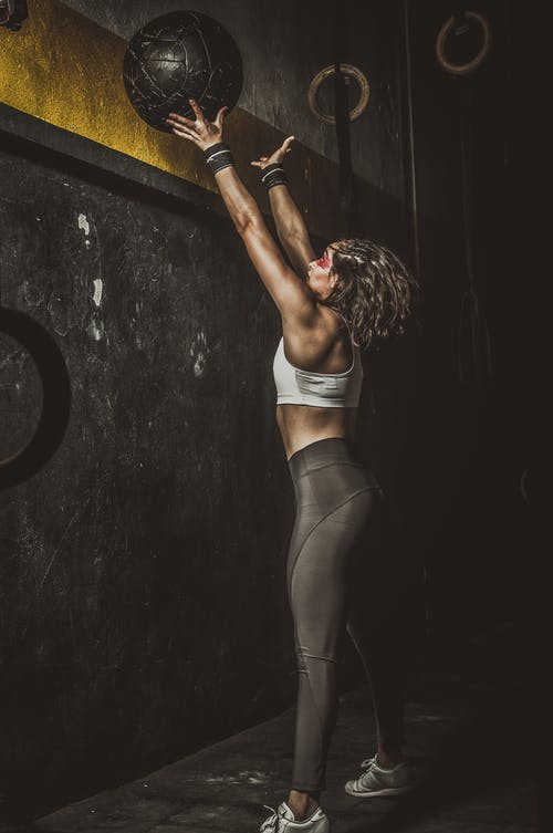 Woman in Black Lingerie Bending Her Body