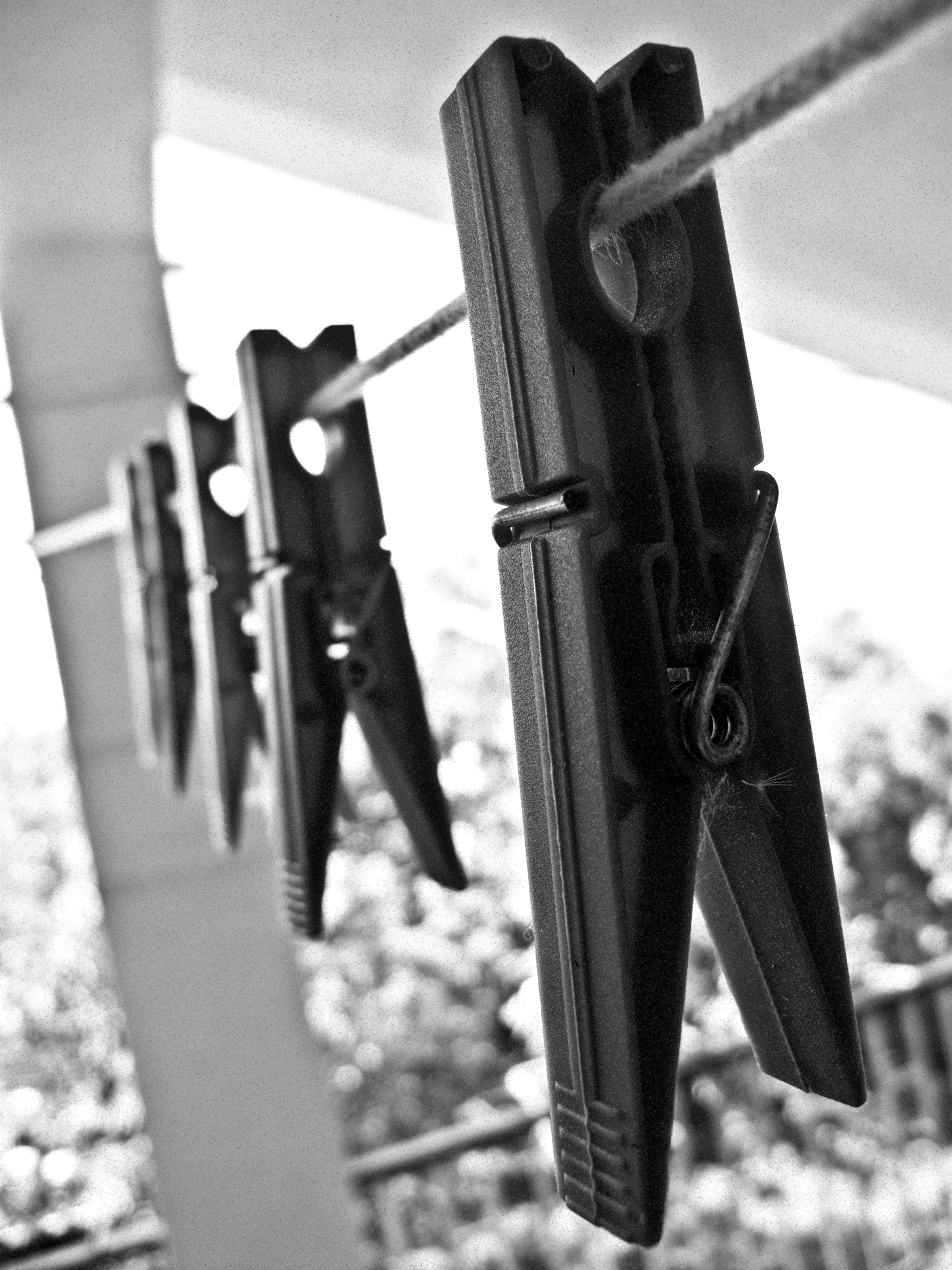 Grayscale Photography of Clothespins