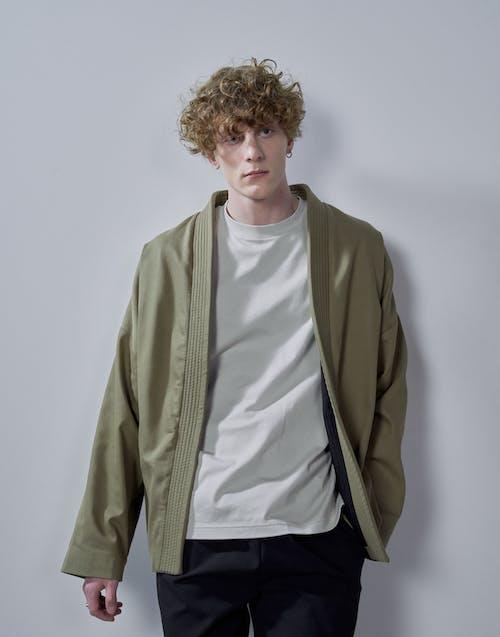 Man in Green Zip Up Jacket