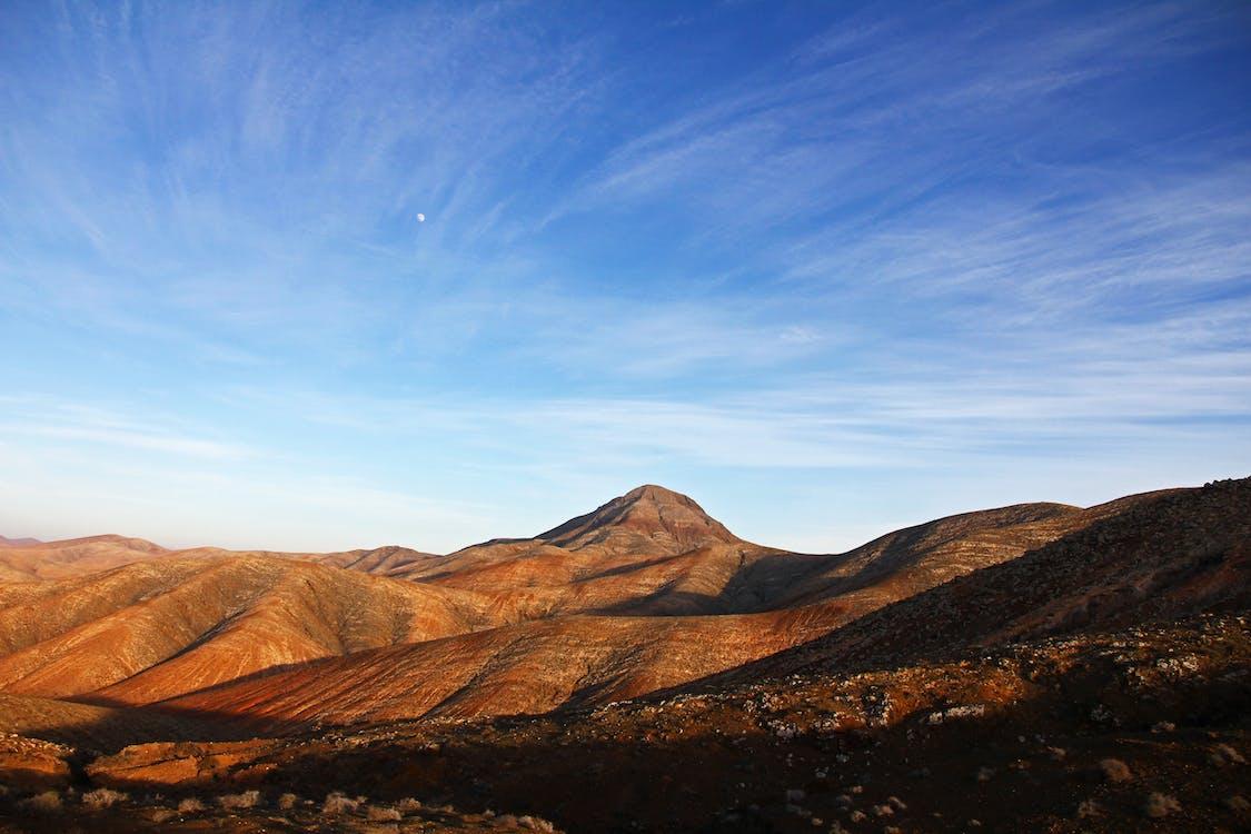Blue Sky Under Brown Mountain
